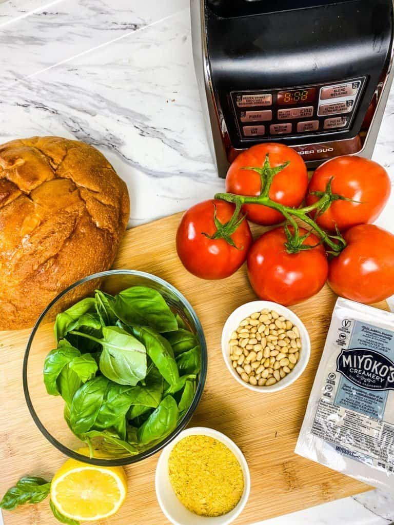 Ingredients to make a vegan tomato pesto mozzarella sandwich