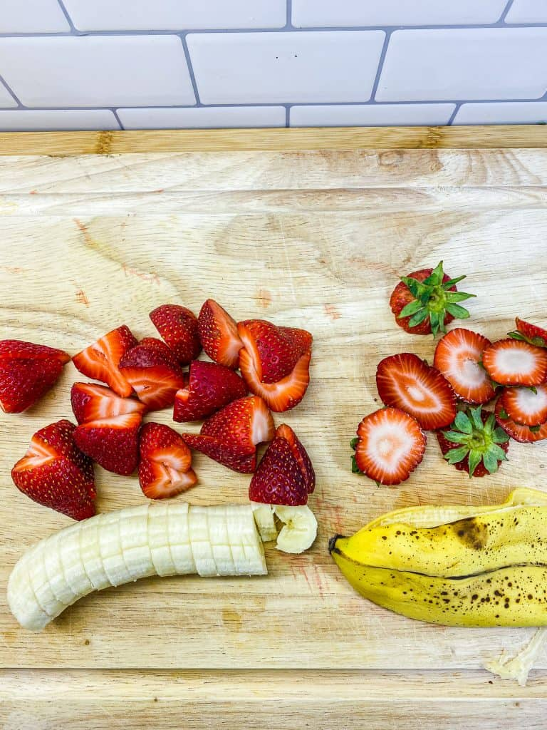 fresh cut strawberries and bananas to be used as toppers in oatmeal