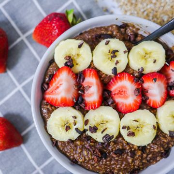 Healthy Chocolate Strawberry Banana Oatmeal topped with Cocoa Nibs
